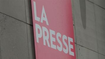 Enseigne de La Presse sur le bâtiment extérieur à Montréal.